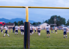 American football goal posts with blurred team Royalty Free Stock Images