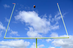 American Football and Goal Posts Royalty Free Stock Photo