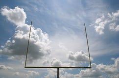 American football goalpost. Against cloudy sky background Stock Photo