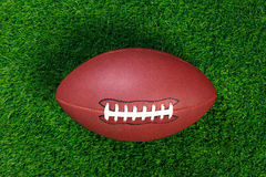 American football on grass royalty free stock photo