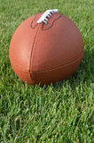 American Football on Grass Field Stock Photo