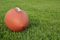 American Football on Grass Field Stock Photography