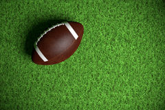 American Football on the grass Royalty Free Stock Images