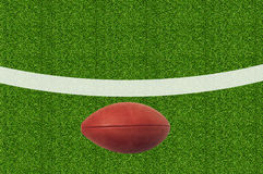 American football on green grass Stock Photography
