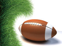 American football on green grass backgrou Stock Photo