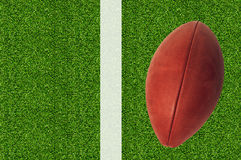 American football on green grass Royalty Free Stock Image