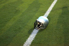 American Football Helmet. On the Field with room for copy Royalty Free Stock Photography
