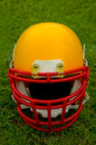 American football helmet. In grass Royalty Free Stock Photography