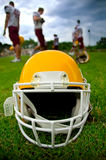 American football helmet. In grass Royalty Free Stock Images