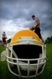 American football helmet. In grass Stock Images