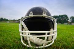 American football helmet. In grass Royalty Free Stock Photo