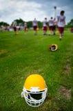 American football helmet. In grass Stock Photo