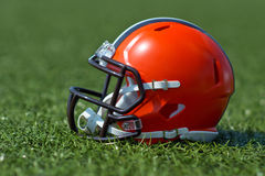 American football helmet. At the artificial grass playing field Royalty Free Stock Image