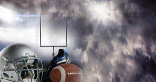 American football helmet ball and gear equipment with stadium transition. Digital composite of American football helmet ball and gear equipment with stadium Royalty Free Stock Photo