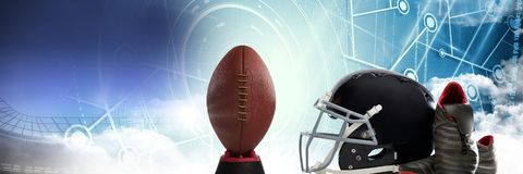 American football helmet ball and gear with technology transition. Digital composite of American football helmet ball and gear with technology transition Royalty Free Stock Images