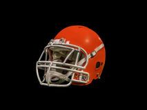 American football helmet  on black background. Red American football helmet  on black background with detailed clipping path Stock Image