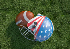 American football helmet decorated as US flag and ball, on the grass. American football helmet, decorated as American stars and stripes flag and oval ball, on Stock Image