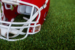 An american football helmet on the field. Close up view of an american football helmet on the field Royalty Free Stock Photos