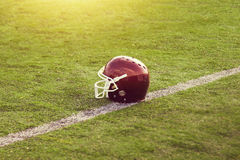 American Football Helmet on the field Royalty Free Stock Photography