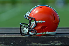 American football helmet. At the playing field Royalty Free Stock Photos