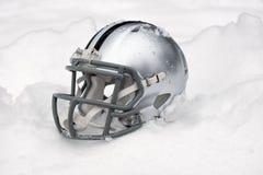 American football helmet in snow Stock Images