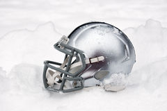 American football helmet in snow Stock Photography