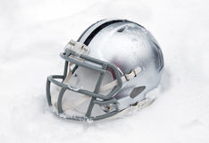 American football helmet in snow Royalty Free Stock Photography