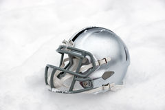 American football helmet in snow Royalty Free Stock Image