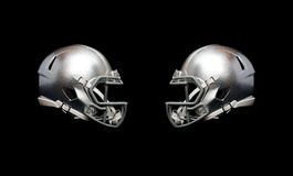 American football helmet. Two american football helmet isolated on black background Royalty Free Stock Image