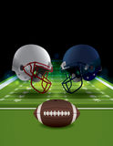 American Football Helmets Clashing on Football Field Stock Image