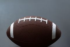 American football isolated on black background. Sport object concept stock photo
