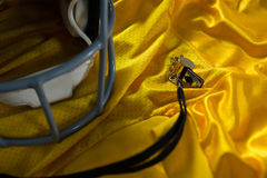 American football jersey, referee whistle and head gear Stock Images