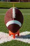 American Football on Kicking Tee Closeup Royalty Free Stock Images