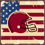 American football label with helmet and flag Stock Image