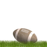 American football laying in the grass Stock Photo