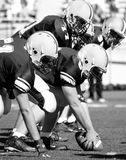American Football, Linemen. Offensive Linemen geting ready to snap the football Determination Strong Stock Images