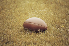 American Football lying on the field Royalty Free Stock Photo