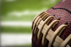 American Football. Macro of a vintage worn american football ball with visible laces, stitches and pigskin pattern royalty free stock photo