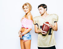 American football man player with beautiful girl cheerleader posing in uniform, ball Stock Photos