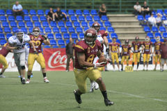 American Football Match Between Wolves And Blue Dragon Stock Photo