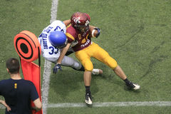 American Football Match Between Wolves And Blue Dragon Stock Photos