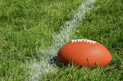American Football on Natural Grass Field Royalty Free Stock Image