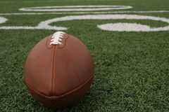 American football near the fifty. Yard line Stock Image