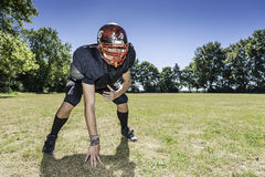 American Football Offensive Lineman in action. American football player offensive Lineman in in action at three point stance Royalty Free Stock Image