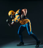American football offensive player with ball Stock Photography