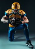 American football offensive player with ball Stock Photos