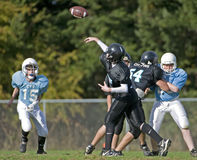 American football pass stock images