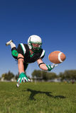 American football player. Diving and catching the ball Royalty Free Stock Photo