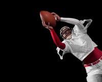 American football player. Studio shot over black Stock Photography