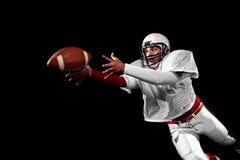 American football player. Studio shot over black Royalty Free Stock Photo